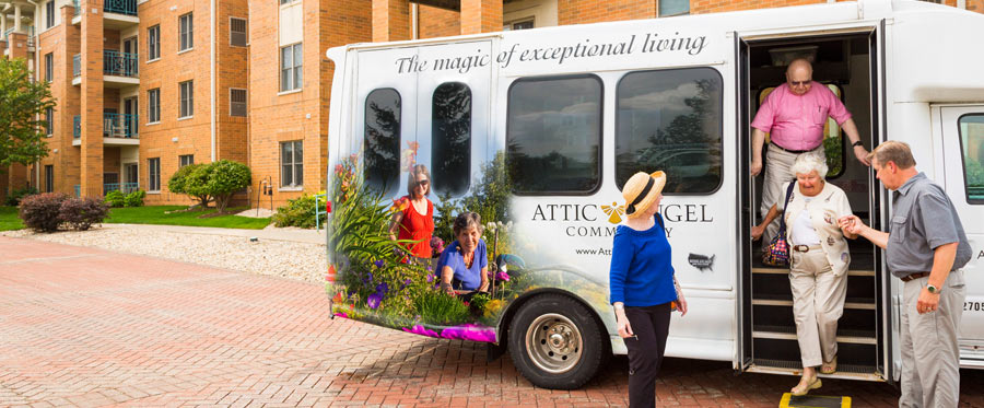 Attic Angel Community in Middleton WI and Madison WI bus with vehicle wrap and elderly people getting off