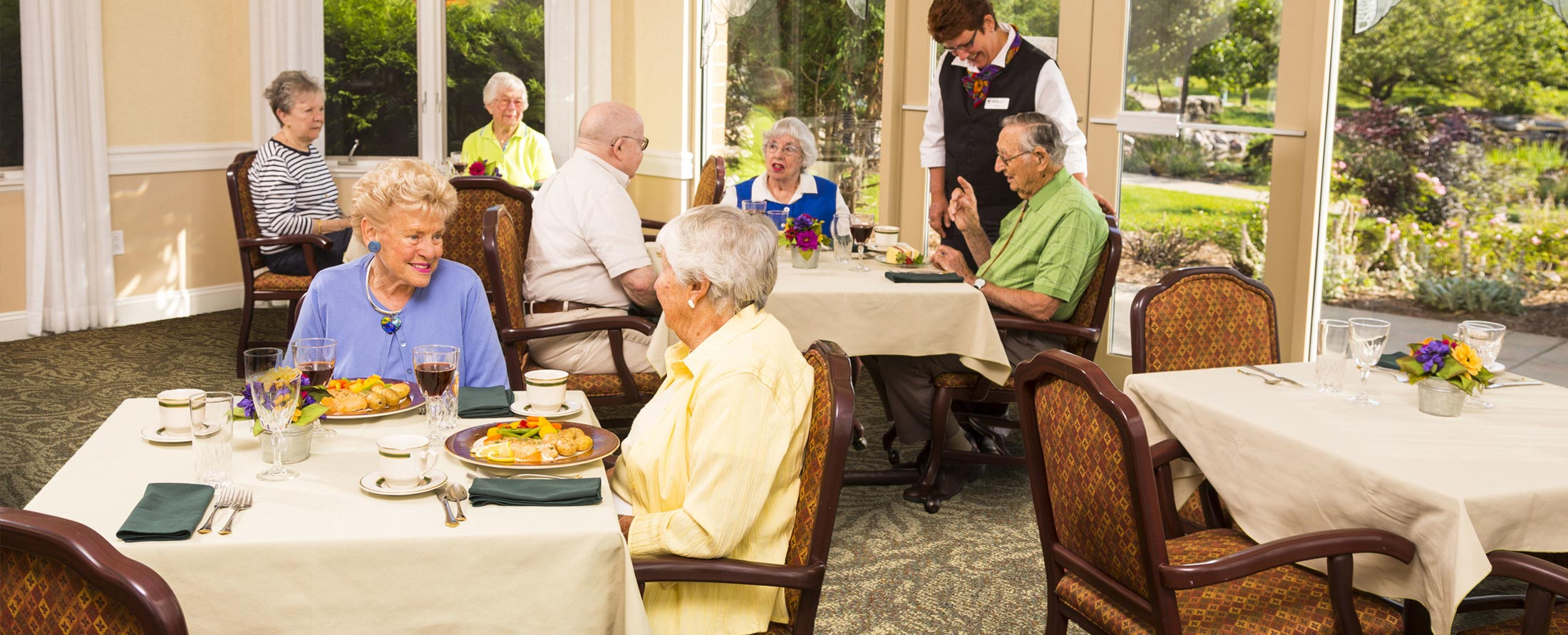 elderly men and women dining at Attic Angel Community